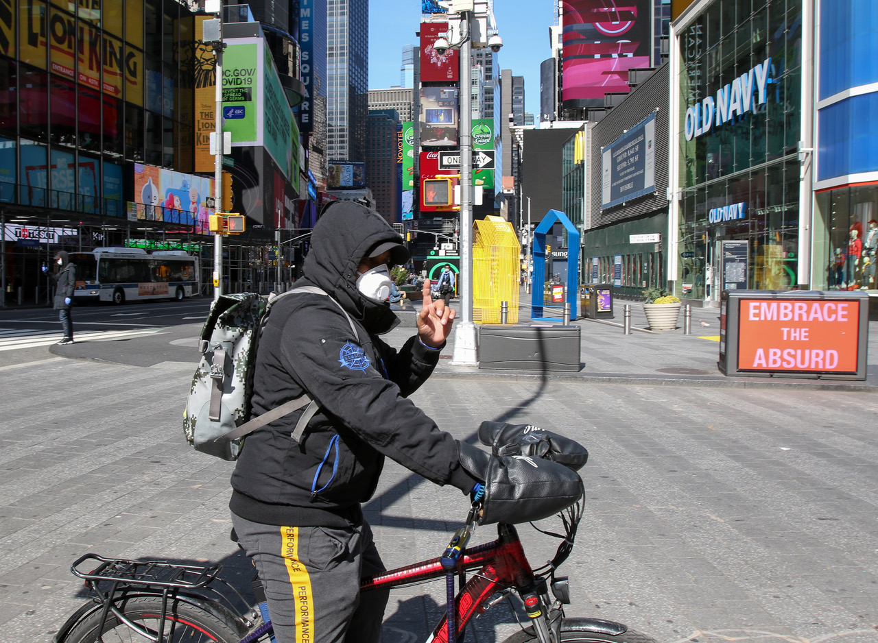 Masked cyclist in empty Times Sq during Covid19 quarantine in New York, Photo by Alcir N. Silva